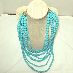 7 Strand Multi Sized Turquoise Colored Necklace